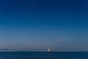 New Dungeness Spit lighthouse under the stars, an hour after sunset. Sequim WA