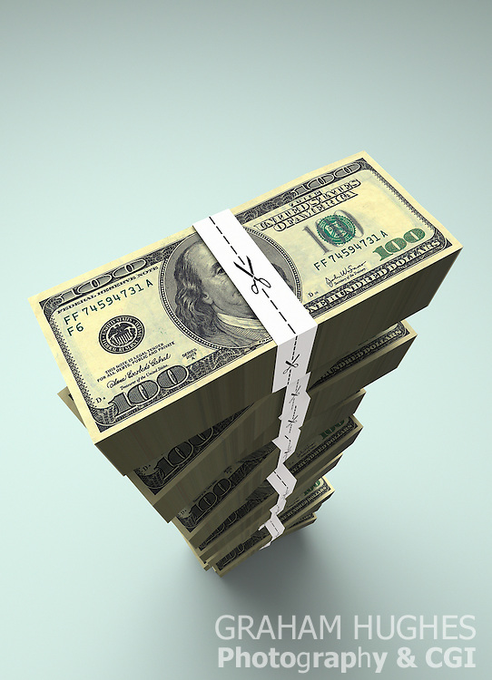 Large stack of $100 dollar bills with money ties with scissors cutting along dotted line.