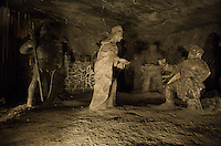 Wieliczka Salt Mine, Poland. The sculptures illustrate one of the oldest legends of the Wieliczka Mine..When the Hungarian Princess Kinga married the Polish Prince Boleslaus the Chaste, she received as a dowry one of the salt mines in the Marmaros region of Hungary, and she cast her engagement ring into the mine. The ring miraculously travelled to Wieliczka together with the salt deposits, and was found in the first block of white gold dug in Wieliczka.