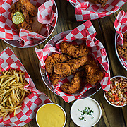 Joella's Hot Chicken's various fried chicken and sides. Joella's Hot Chicken is set to open at 3400 Frankfort Ave. on September 1st.