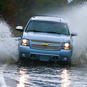 10/30/12 - Smyrna, DE - Hurricane Sandy - Motorist driving a 2012 Chevrolet Tahoe drives though flooded woodland beach road Tuesday, Oct. 30, 2012, in Smyrna DE.<br /> <br /> SAQUAN STIMPSON/Special to The News Journal