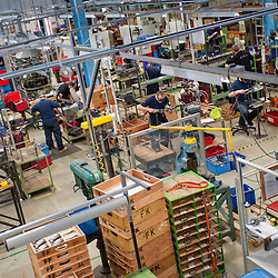 London, UK - 29 January 2013: workmen braze and assemble folding bikes in the Brompton Bicycle factory in South West London. The company was founded in 1976 by Andrew Ritchie and is one of only two major frame manufacturers still based in the UK. The 22,000 ft² Brompton Bicycle factory is on an industrial site nestled between railway lines and a motorway. The brazing, assembly and engineering areas share one building with the office space.