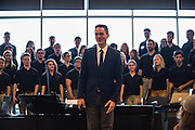 Timothy Westerhaus, GU director of choirs and vocal studies, leads a performance of high school and GU choirs. (Gonzaga photo)
