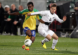 New Zealand's Michael McGlinchey challenges Solomon Islands' Leslie Nate in a FIFA World Cup Qualifier Match, North Harbour Stadium, Auckland, New Zealand, Tuesday, September 11, 2012.  Credit:SNPA / David Rowland