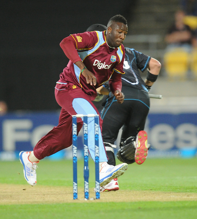 West Indies Andre Russell chases down the ball against New Zealand in the second T20 International cricket match, Westpac Stadium, Wellington, New Zealand, Wednesday, January 15, 2014. Credit:SNPA / Ross Setford