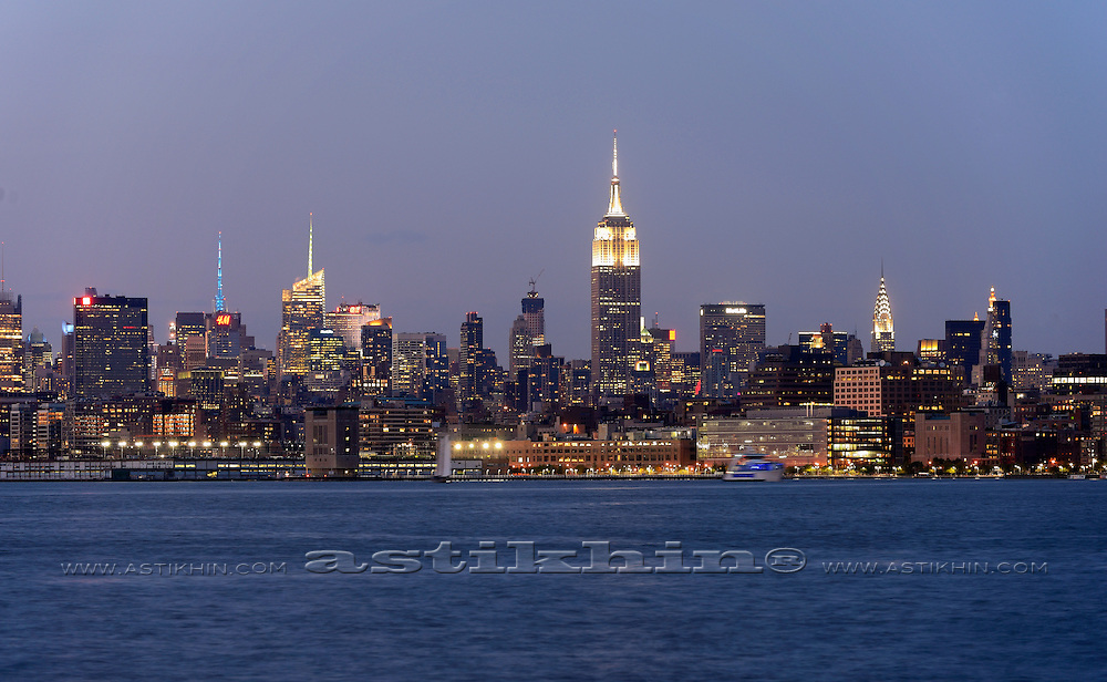New York City, Empire State Building and the Chrysler Building in twilight.