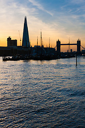 London, March 10th 2015. The sun sets over London after a warm early spring day. PICTURED: Dutch sailing barges tied up at Hermitage Moorings in Wapping with the Shard and Tower Bridge, two Iconic London silhouettes as a backdrop