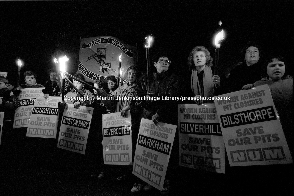 Women Against Pit Closures hold a torchlight vigil at Grimethorpe Pit with placards listing the 31 threatened collieries 15 December 1992