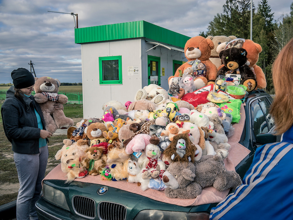 A man sells stuffed animals at a gas station on Sunday, October 11, 2015 in Babruysk, Belarus. President Alexander Lukashenko was elected to a fifth term today in a vote that most international observers considered deeply flawed.