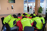 A tired Taipeil team naps before the start of the next part of the swimming competition at the International Children`s Games.