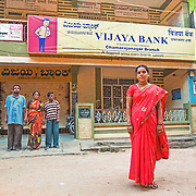 CAPTION: Shobha has taken up a job as a sweeper at Vijaya Bank in order to help support her two brothers, Siddaraju and Shivaraju, who both have severe learning disabilities. Through the Chamkol programme, families like hers are able to get support in devising Individual Livelihood Plans to build pathways out of poverty. LOCATION: Mudlumole (village), Kasaba (hobli), Chamrajnagar (district), Karnataka (state), India. INDIVIDUAL(S) PHOTOGRAPHED: From left to right: Siddaraju, Jayamma, Shivaraju and Shobha.