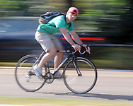 A cyclist rides a bike on University Avenue in Oxford, Miss. on Friday, April 16, 2010.