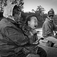 Vera and Peter Spein head to fish camp with their son Bennett. Subsistence activities near the village of Kethluk in southwest Alaska.
