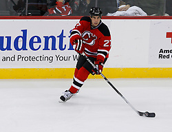 Nov 1, 2008; Newark, NJ, USA; New Jersey Devils defenseman Mike Mottau (27) skates with the puck during the third period at the Prudential Center. The Devils defeated the Thrashers 6-1.