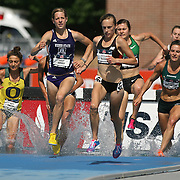 BUSH - 13USA, Des Moines, Ia. - Nicole Bush was the early leader in the steeplechase.   Photo by David Peterson