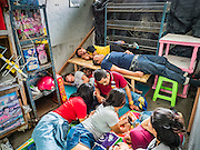 03 SEPTEMBER 2016 - BANGKOK, THAILAND:  People sleep and relax behind a barricaded gate at Pom Mahakan Fort. Hundreds of people from the Pom Mahakan community and other communities in Bangkok barricaded themselves in the Pom Mahakan Fort to prevent Bangkok officials from tearing down the homes in the community Saturday. The city had issued eviction notices and said they would reclaim the land in the historic fort from the community. People prevented the city workers from getting into the fort. After negotiations with community leaders, Bangkok officials were allowed to tear down 12 homes that had either been abandoned or whose owners had agreed to move. The remaining 44 families who live in the fort have vowed to stay.     PHOTO BY JACK KURTZ