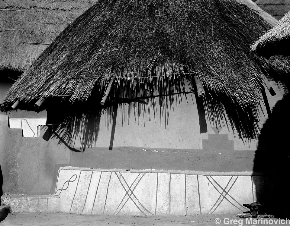 A neglected hut in the sacred royal village of Shongwezi in the mountains above Louis Trichardt, Limpopo Province South Africa, July1989. The Mphephu royalty are buried in a sacred grove here, and the village exists to protect and serve the spirits of the ancestors.  Greg Marinovich