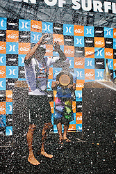 HUNTINGTON BEACH, California/USA (Sunday,Aug 7, 2011) 10-Time ASP World Champion Kelly Slater (Cocoa Beach, FL), 39, gets the classic champagne shower at the awards ceremonies platform late afternoon  at  the U.S. Open of Surfing 2011. Photo: Eduardo E. Silva.