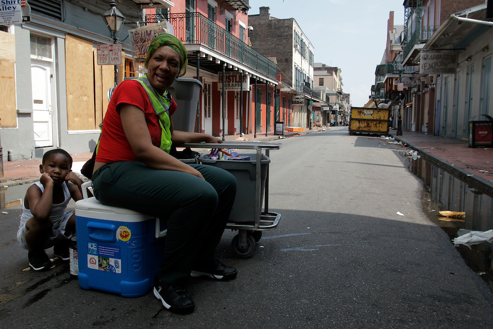 Nelletha Hughes sits with her son Karnell Hughes, 5, in the middle of Bourbon Street Wednesday, August 31, 2005, in the french quarter of New Orleans, La. Hughes was waiting for her husband and sons to return with news of how they were going to get out of the city. Scott Morgan