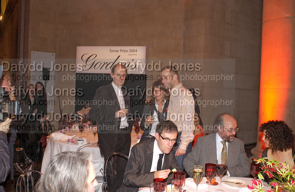 Richard Cork, Tracey Emin and Wolfgang Tillman, Dexter Dalwood sitting. 2004 Turner prize. Tate Britain. 7 December 2004. ONE TIME USE ONLY - DO NOT ARCHIVE  © Copyright Photograph by Dafydd Jones 66 Stockwell Park Rd. London SW9 0DA Tel 020 7733 0108 www.dafjones.com