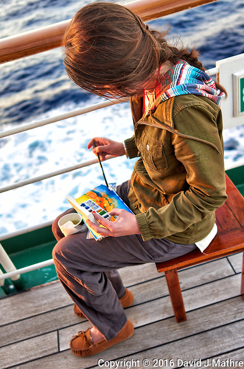 Grace working on a water color painting in the late afternoon sun. Aft deck of the MV World Odyssey crossing the Pacific Ocean. Semester at Sea, 2016 Spring Semester Voyage. Day 2 of 102. Image taken with a Leica T camera and 23 mm f/2 lens (ISO 100, 23 mm, f/2, 1/80 sec).