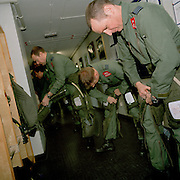 Pilots of the 'Red Arrows', Britain's Royal Air Force aerobatic team zip themselves into their g-pants before training flight. G-pants counteract the effects of high gravity stresses that jet-fighters impose on the human body, automatically inflating and squeezing blood back to the thorax and head when blood drains towards the legs.
