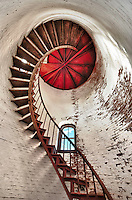 New England Lighthouse spiral staircase.  Hand held, seven-frame HDR exposure.  I had a rare and unexpected opportunity to gain entrance to this lighthouse on private property along the New England coastline.  No time for any sort of elaborate set-up, just a series of quick, high-speed bracketed bursts.  I am honoring the owner's request to not reveal the exact location of the property.