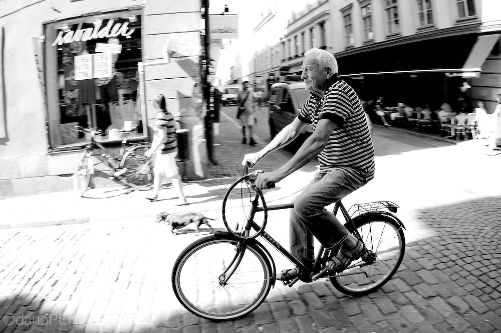 A Stockholm resident rides his bike through the old town.