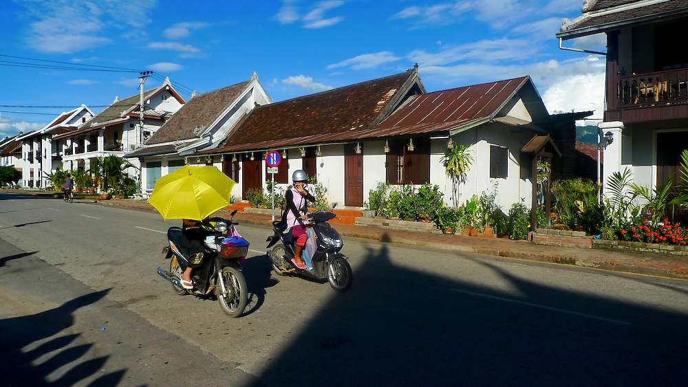 Two women in their motorcycle in the streets of Luang Prabang. @ Martine Perret. 24 May 2010