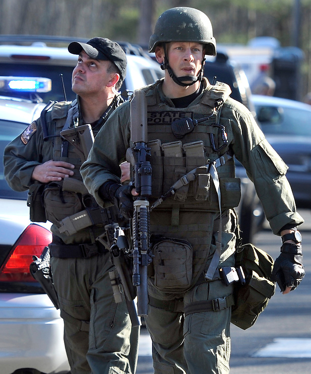 State Police SWAT walk away from Sandy Hook Elementary School after a shooting at the school in Newtown, Conn., Dec. 14, 2012. (AP Photo/Jessica Hill)