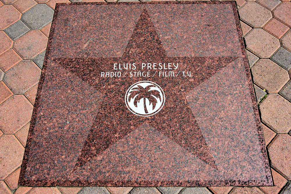 Elvis Presley Star at Walk of Stars in Palm Springs, California<br /> The Hollywood Walk of Fame is only 112 miles from Palm Springs, so you might assume these stars are mimicking the famous version. The distinction is all of the honored celebrities once lived in Palm Springs. The majority are from show business. You will also find civic leaders, literary artists and three former presidents. There are over 300 of these bronze stars along the Palm Springs Walk of Stars on Palm Canyon Drive in downtown.
