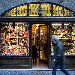Bergamo, Italy - A child enters running in a toy store in Via Gombino, the main street of the historical centre of Città Alta, Upper Bergamo