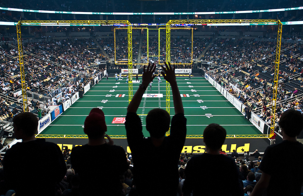 Pittsburgh Power fans cheer as the Power scores a touchdown in a game against the Philadelphia Soul at Consol Energy Center on March 17, 2011.  © 2011 Shelley Lipton.
