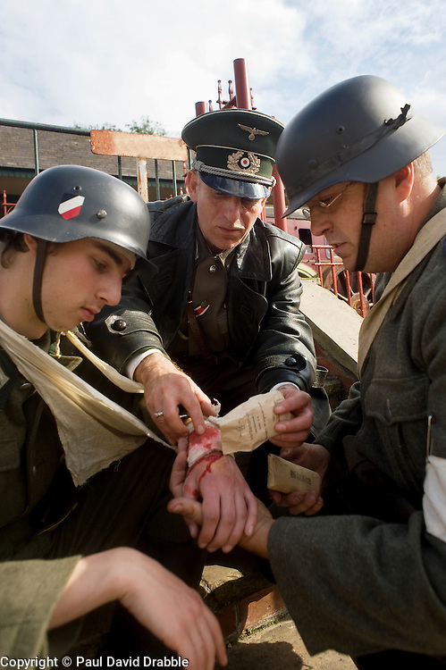 Re-enactors portraying a doctor and a field medic tend a wounded comrade from Infantry Regiment Gro&szlig;Deutschland during a living history display Image <br /> &copy; Paul David Drabble