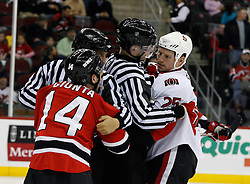 February 13, 2008; Newark, NJ, USA;  Linesmen separate New Jersey Devils right wing Brian Gionta (14) and Ottawa Senators right wing Chris Neil (25) during the second period at the Prudential Center in Newark, NJ.