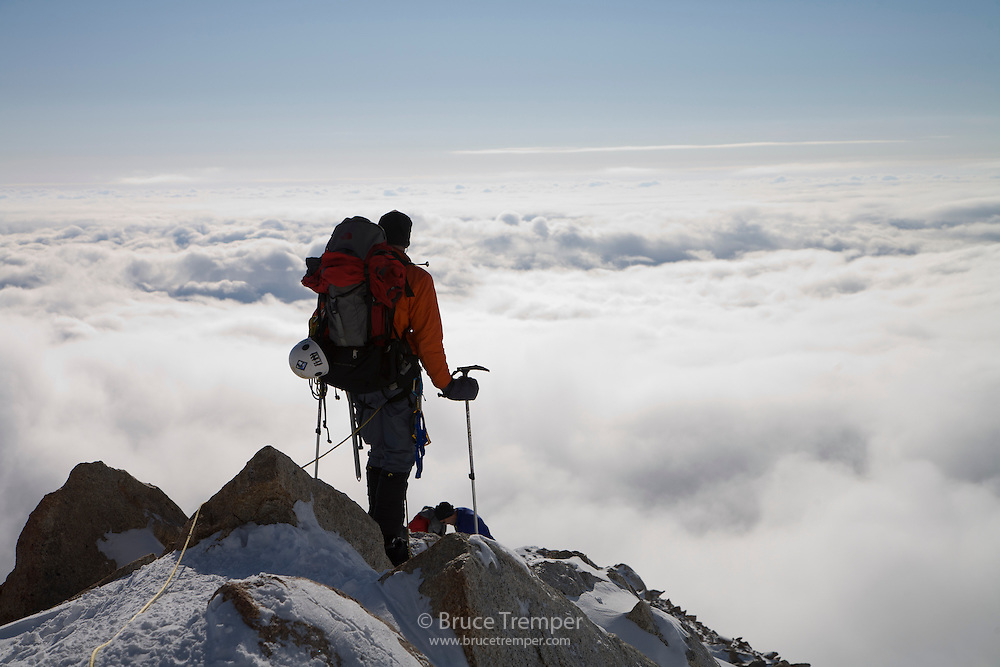 Enjoying the view above the clouds while descending Mt. McKinley, Denali National Park, Alaska
