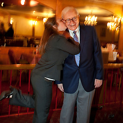 Warren Buffett poses with business students from universities around the country after at lunch at Piccolo Pete's Restaurant in Omaha, Neb., Nov. 11, 2011. Here, Buffett poses with Hillary Burford of Northern Arizona University.
