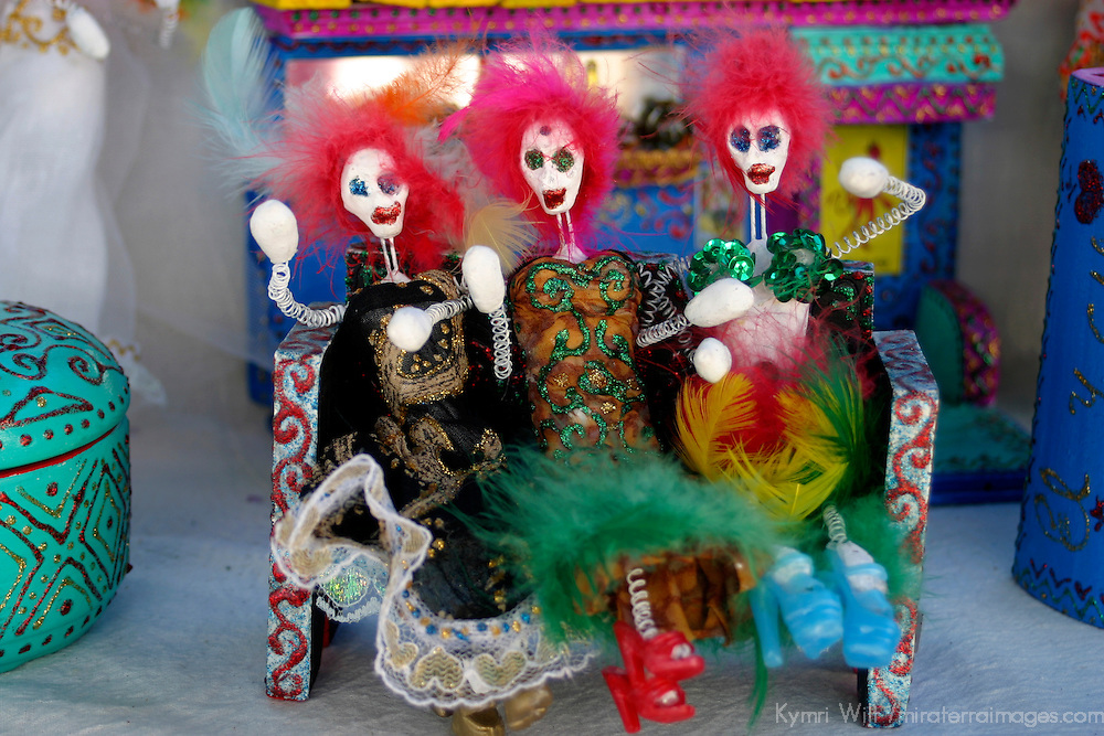 Americas, Mexico, Guanajuato. Three Catrinas (skeletons) on bench make a colorful souvenir from Mexico, where death is joyfully depicted as a woman.