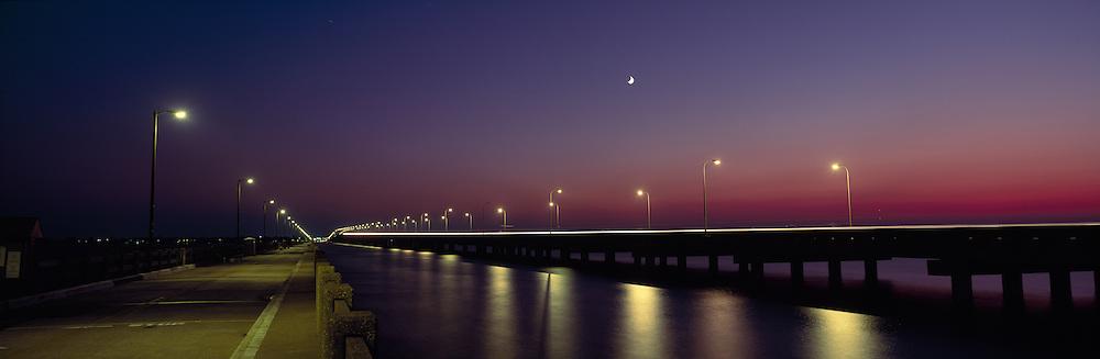 USA, Maryland, Cambridge, Traffic lights blur across bridge across Choptank River on summer evening
