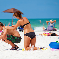 SARASOTA, FL -- June 14, 2011 -- Devin Bledsoe, 20, of Memphis, Tenn, center, applies sunscreen on her brother, Mason, 15, left, as they prepare to take in the sun while on vacation at Siesta Public Beach in Sarasota, Fla., on Tuesday, June 14, 2011.