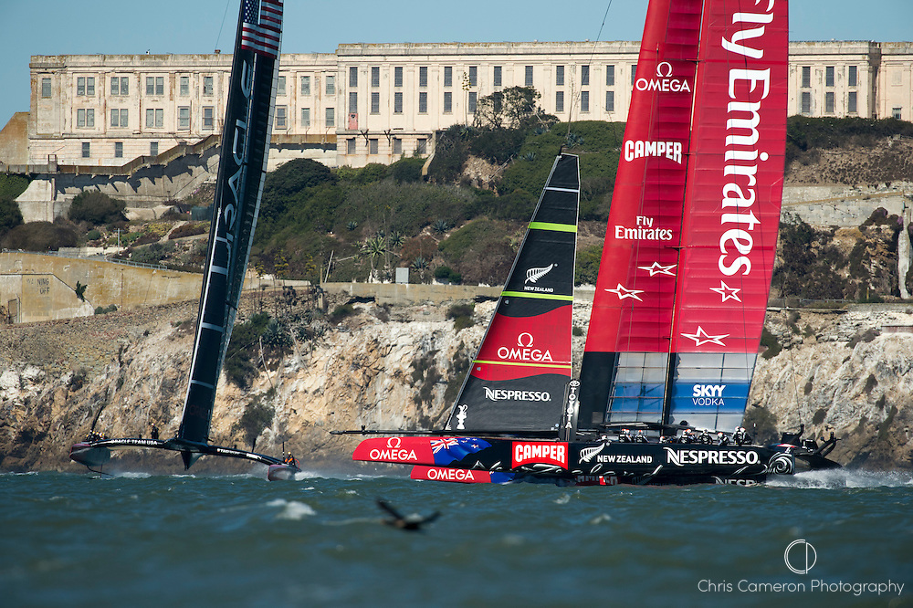 Emirates Team New Zealand cross ahead of Oracle Team USA on the windward leg in race ten on day six of America's Cup 34. 15/9/2013
