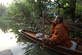 Thailand. Monks who collect alms - by boat!