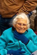 Senior woman watching Miles City Bucking Horse Sale Parade, Montana