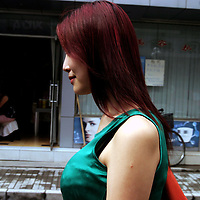 """BEIJING, 29.July 2004 : Yang Yuan, 19, an aspiring model who made headlines in May when she sued the organizer of a beauty pageant, walks in a street outside the hospital where she went under the knife in Beijing, July 29, 2004, in China. ..Yang Yuan says she wanted to improve her career chances and therefore improved her looks artificially.When the organizer of the beauty contest found out, he banned her from competing and Yang's """"nightmare"""" started. Yang has spent a fortune to pay her team of lawyers, organize press conferences to fight for her rights...These days, she's been obliged to give up her apartment as she slowly runs out of money and model jobs are not coming .In order to make a living, Yang agreed to act as an """"ambassador"""" for the hospital where she had her plastic surgery...Plastic surgery gradually is becoming big business in China's capital.  Since this summer , hospitals  have been flooded with teenage patients ever since offers """"special summer reductions"""" for students were made..  ..Whereas in Mao Zedong's China, even pigtails were seen as a sign of vanity (and had to be cut off) , nowadays, urban Chinese women seek about every means in order to distinguish themselves from the masses.  This year Beijing will organize the worl'd first beauty pageant for women had had plastic surgery..."""