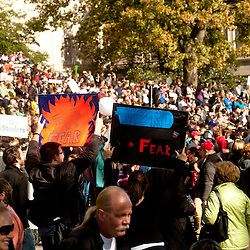 "Washington, DC, October 30, 2010 - Jon Stewert and Steven Colbert host the Rally To Restore Sanity and/or Fear.  Tens of thousands of ralliers donned costumes and carried signs. ""THIS IS A SIGN OF FEAR"""