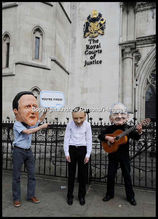 Culture Secretary Jeremy Hunt arrives at the Leveson Inquiry to give evidence, High Court, London, Thursday May 31, 2012.  Photo By Andrew Parsons/i-Images.Protesters wearing Jeremy Hunt, David Cameron and Rupert Murdoch masks outside the Royal Courts of Justice as the Culture Secretary Jeremy Hunt gives evidence at the Leveson Inquiry at High Court, London, Thursday May 31, 2012.  Photo By Andrew Parsons/i-Images.