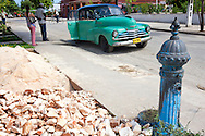 Car and hydrant in Floro Perez, Holguin, Cuba.