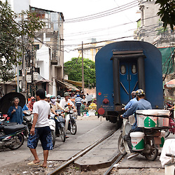 HANOI, VIETNAM, SEPTEMBER 7: a train passing in a narrow street in Hanoi with no safety barriers, September 7, 2010. In the first 11 months of 2009, there have been 391 railway accidents, leading to 178 fatalities and 259 injuries in Vietnam