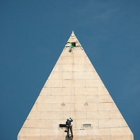 Dan Gach, of Denver, CO., an engineer with Wiss, Janney, Elstner Associates, inspects the side of the Washington Monument from at over 500 feet above the ground September 29, 2011 as a commercial airline flies overhead. The monument was damaged by the August 23rd earthquake.  Photo Ken Cedeno.