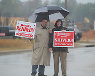 Lafayette County coroner candidates Rocky Kennedy (left) and Richard Shivers holds a campaign sign as voters go to the polls in the rain at the Oxford Conference Center in Oxford, Miss. on Tuesday, November 2, 2010.